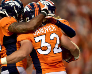DENVER, CO - SEPTEMBER 08:  Fullback Andy Janovich #32 of the Denver Broncos celebrates with teammates after he scores on a 28-yard touchdown run against the Carolina Panthers in the second quarter at Sports Authority Field at Mile High on September 8, 2016 in Denver, Colorado.  (Photo by Dustin Bradford/Getty Images)